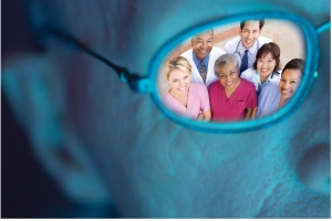 Image of glass lens looking at health care team, from patient's perspective.